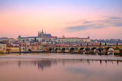 View of Prague castle and Charles bridge at colorful sunrise Stock Photos