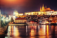 View of Prague castle from Charles bridge at night Stock Photography