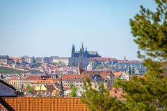 View of Prague Castle over red roof from Vysehrad area at sunset lights, Prague, Czech Republic. View of Prague Castle over red roof from Vysehrad area at sunset royalty free stock image