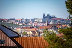 View of Prague Castle over red roof from Vysehrad area at sunset lights, Prague, Czech Republic. View of Prague Castle over red roof from Vysehrad area at sunset stock photos