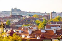 View of Prague Castle over red roof from Vysehrad area at sunset lights, Prague, Czech Republic. View of Prague Castle over red roof from Vysehrad area at sunset stock image