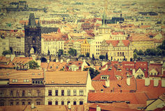View of Prague with Charles Bridge, retro style. Royalty Free Stock Photography