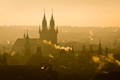 View of Prague city towers in misty morning sunrise Stock Photo