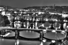 View on the Prague cityscape together with the bridges crossing the vltava river passing through the city, all in black and white Stock Photography