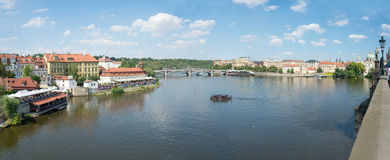 View of Prague from Moldava river - Prague- Czech Republic. PRAGUE - AUGUST 5: View from Charles Bridge of the banks of the Vltava River with its typical bars Royalty Free Stock Photos