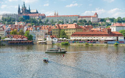 View of Prague from Moldava river - Prague- Czech Republic. PRAGUE - AUGUST 5: View from Charles Bridge of the banks of the Vltava River with its typical bars Stock Photos
