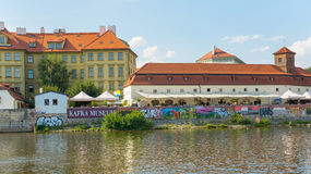 View of Prague from Moldava river - Prague- Czech Republic. PRAGUE - AUGUST 4: View from the ship of the banks of the Vltava River with its typical bars and Royalty Free Stock Photos