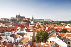View of Prague rooftops and St. Vitus Cathedral and red roofs. Stock Image
