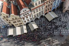 The view from Prague`s astronomical clock tower. The shot was taken from the tower during a round hour. At this time people are watching the hourly Apostles show Stock Image