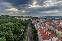View of Prague taken from Nuselsky bridge on sunset captures typical local architecture from aerial perspective. Famous Vysehrad castle is behind it Stock Photography