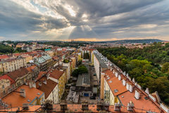 View of Prague taken from Nuselsky bridge on sunset captures typical local architecture from aerial perspective. Famous Vysehrad castle is behind it Stock Photos
