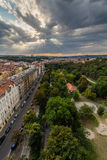 View of Prague taken from Nuselsky bridge on sunset captures typical local architecture from aerial perspective. Famous Vysehrad castle is behind it Royalty Free Stock Photography