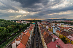View of Prague taken from Nuselsky bridge on sunset captures typical local architecture from aerial perspective. Famous Vysehrad castle is behind it Stock Photo