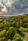 View of Prague taken from Nuselsky bridge on sunset captures typical local architecture from aerial perspective. Famous Vysehrad castle is behind it Stock Images