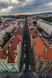 View of Prague taken from Nuselsky bridge on sunset captures typical local architecture from aerial perspective. Famous Vysehrad castle is behind it Royalty Free Stock Photos