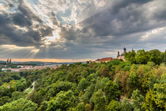View of Prague taken from Nuselsky bridge on sunset captures typical local architecture from aerial perspective. Famous Vysehrad castle is behind it Royalty Free Stock Photo