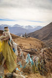 View of prayer flags and pagoda in Drak Yerpa, Tibet Stock Photo
