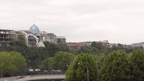 View of the Presidential Palace in Avlabari and the highway, Tbilisi, Georgia. Overcast day stock footage