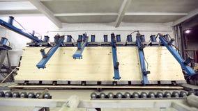 View on pressing of laminated veneer lumber stock video