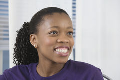 View of a pretty young black woman smiling. Royalty Free Stock Photo