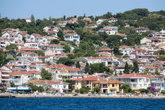 View of Princes Islands of Burgaz Adasi hillside with luxury residential housing on coast, Turkey Stock Photography