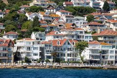 View of Princes Islands of Kinaliada hillside with luxury residential housing on coast, Turkey Stock Image