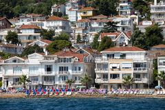 View of Princes Islands of Kinaliada hillside with luxury residential housing on coast, Turkey Stock Photos