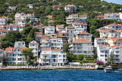 View of Princes Islands of Kinaliada hillside with luxury residential housing on coast, Turkey Stock Images