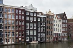 View from the Prins Hendrikkade street in Amsterdam to the old historical dutch buildings. View from the Prins Hendrikkade street in Amsterdam to the old Royalty Free Stock Images