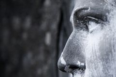 View in profile of an ancient statue of Mary Magdalene. Close up. Of sculpture. religion, faith, holy, Christianity concept stock image