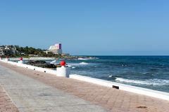 View of the promenade on the eastern shore of the ocean in Isla Mujeres, Mexico. Royalty Free Stock Photography