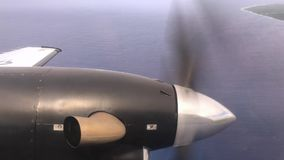 Propeller on a Military Airplane as Seen from Landing Plane. A view of the propeller on a military airplane as it prepares for landing stock footage