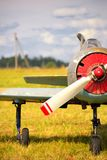 View on propeller on old russian airplane on green grass Royalty Free Stock Photos