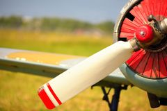 View on propeller on old russian airplane on green grass Royalty Free Stock Photography