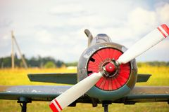 View on propeller on old russian airplane on green grass. View on propeller on old russian airplane Royalty Free Stock Photos
