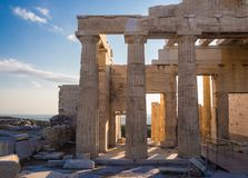 View of Propylaea entrance gateway from Acropolis in Athens, Greece against blue sky stock photos