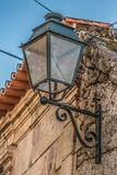 View of a public classic street lamp on exterior wall house.  royalty free stock photos