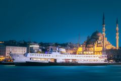 View of public ferry and old district of Istanbul. View of pier, public ferry and old district of Istanbul with Mosque on skyline, Turkey. Clipping path of sky stock image