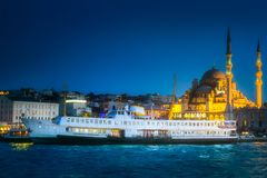 View of public ferry and old district of Istanbul. View of pier, public ferry and old district of Istanbul with Mosque on skyline, Turkey Royalty Free Stock Photography