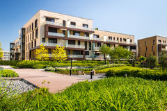 View of public park with block of flats Stock Photography