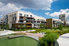 View of public park with newly built modern block of flats Royalty Free Stock Photo