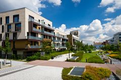 View of public park with newly built modern block of flats Royalty Free Stock Photos