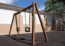 Empty playground swings Stock Photo