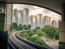 View of public residential housing apartments from LRT station in Bukit Panjang. View of HDB public residential housing apartments from LRT station. The Light royalty free stock image