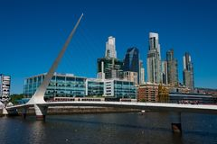 View of Puerto Madero neighborhood waterfront and Woman`s Bridge Puente de la Mujer royalty free stock photography