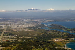View of Puerto Montt, Chile. Bird`s-eye view of Puerto Montt, Chile, with volcano Osorno in the background. Puerto Montt is a port city and commune in south Stock Photo
