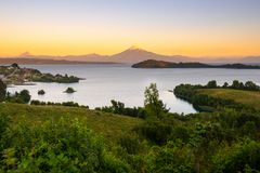 View of Puerto Octay at the shores of Lake Llanquihue. With Osorno Volcano and Puntiagudo Volcano in the back, X Region de Los Lagos, Chile royalty free stock image