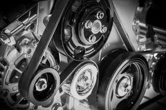 View on pulley and belts on a car engine. Royalty Free Stock Image