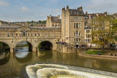 View of Pulteney Bridge and Weir on the River Avon, Bath, England, UK. Bath, England, UK- 04 May 2014: View of Pulteney Bridge and Weir on the River Avon in the Royalty Free Stock Image