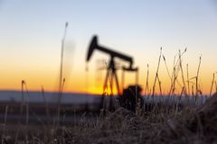 View of Pumpjack at Sunset from Petroleum Area royalty free stock photo